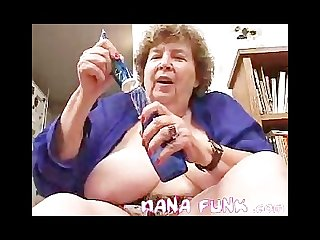 Horny gran playing her old pussy with bottle