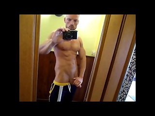 Fit daddy in front of a mirror