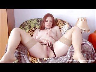 Hot redhead sensually masturbates her pussy