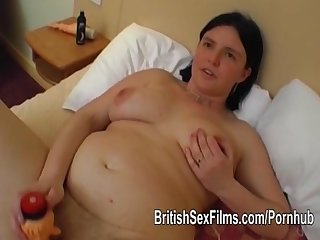 A chubby mature is filmed having sex with toys pushed into her ass