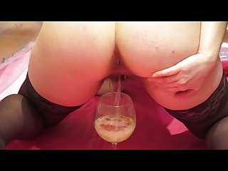 Girl pissing in a glass