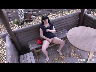 Hidden camera brunette masturbating in a public place