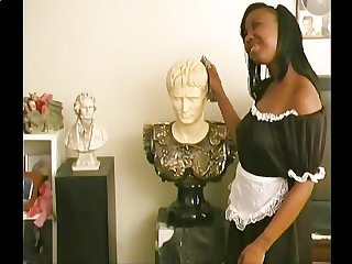 Busty black maid cleans and gives a handjob