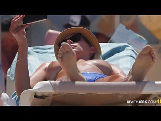 Fucking amazing blonde with perfect tits filmed on topless beach by voyeur
