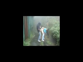 Indian lovers making out in rain outdoor