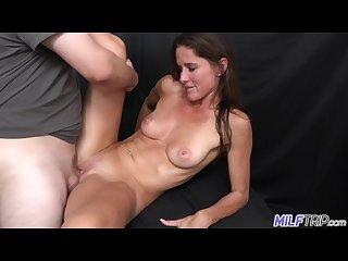 Long legged brunette milf photographer fucks young guy in her photo studio