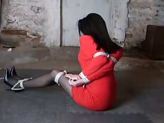 Sexy lady hogtied in red dress