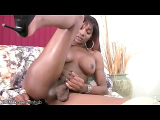 Ebony tranny in fishnet is Shaking and fingering massive ass
