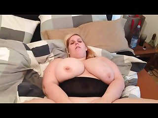 Big boobs lady fingering herself