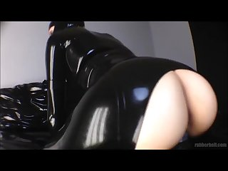 Getting fucked on slippery black rubber sheet in latex catsuit