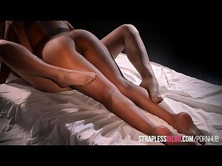 Encased in stockings and fucking with strapless dildo