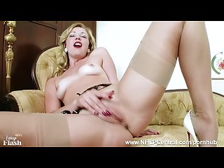 Tasty blonde Lucy lauren frigs herself off in nylons suspenders high heels
