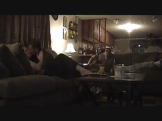 Makingout while husband sit across