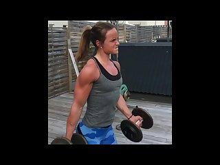 Strong teen girl pumping iron