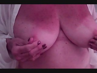 Mature marti of mybigmaturetits playing with and sucking her own nipples