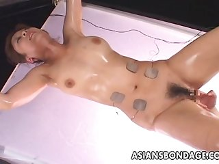 Asian babe is vacuum simulated to her pleasure