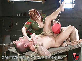 Dominatrix destroys her man slave