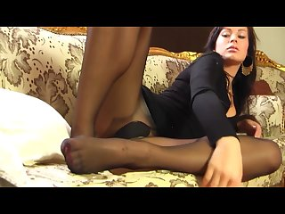 Hot brunette teasing in black seamed pantyhose
