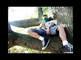 Masked teen strokes and cums in tree
