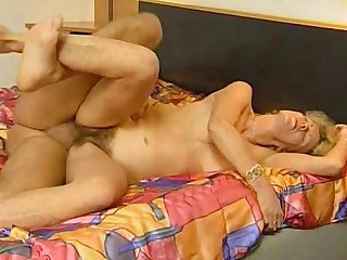 German hairy mature blonde fucks with young man