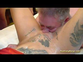 Busty tattooed german in wild gangbang