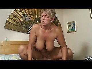 Mature woman fucks her son S friend after catching him masturbating