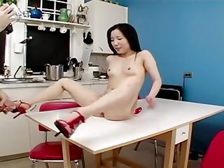 Horny asian cutie fucks on table almond tease s548