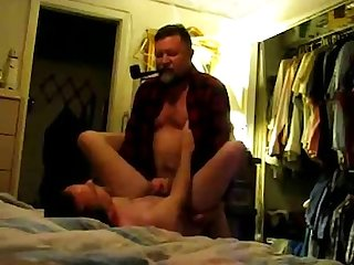 Dad smoking pipe while fucking his boy