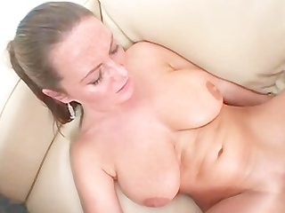 Big tittied milf stuffs a fat cock inside her