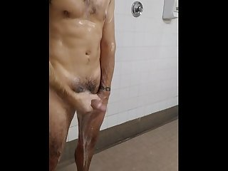 Sexy hairy guy in public shower
