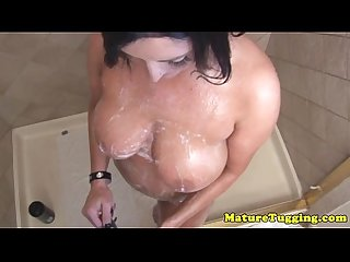 Amateur housewife tugs a cock while showering