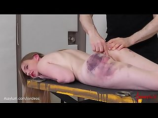 Bruised blond gets fed piss, then hung from her own bandages and fucked in the ass..