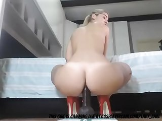 Milf stretching her ass with a dildo