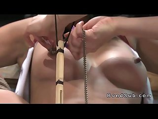 Restrained tanned slave gets lezdom caned