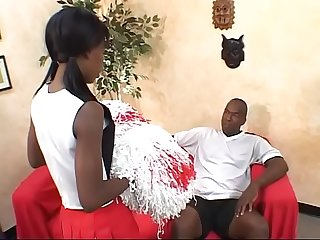 Black cheerleader Lady Armani fucked on red couch