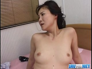 Asian babe gets down and dirty