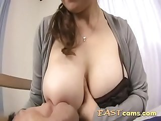 Horny asian man playing with her busty booby asian gf