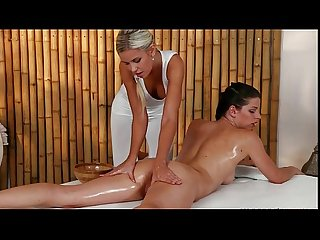 Oiled brunette gets pussy massage