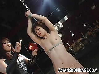 Tied up Asian babe treated to a complete bdsm session