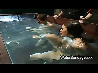 Two bound babes submerged in water