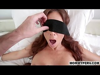 Blindfolded mom has no idea she blows her own son