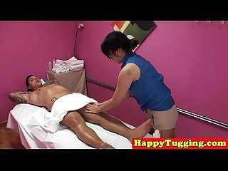 Asian masseuse jerking clients cock on spycam