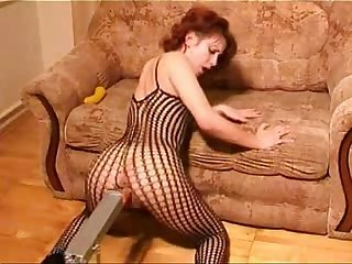 Redhead slut in fishnet masturbates with dildo and fucking machine by lamiatipa