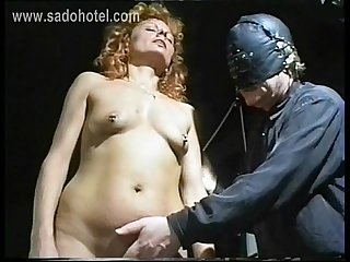 Beautiful milf slave with her pussy and nipples pierced got large needles in her tiny tits by master