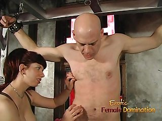 Bald stud enjoys being pleasured by a busty redhead in the dungeon