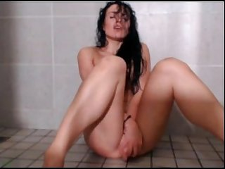 Hot babe plays and masturbates in shower more at 747cams com