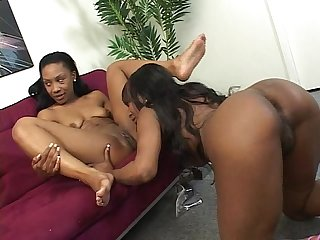 Two ebony lesbos fuck with dildos