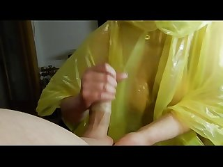 She empties the condom over her face after a blowjob wearing a rain poncho