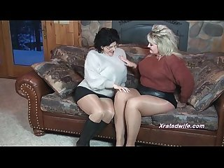 Milfs in sweaters fuck each other with strapon