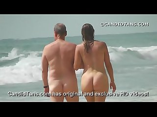 Sexy MILF mom with a big ass walking naked on public beach!